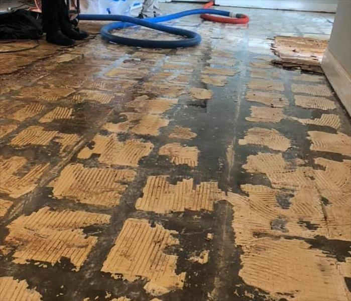 Image shows water damaged tile floor has been removed.