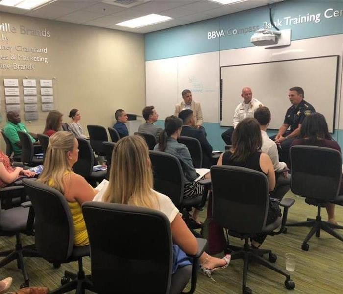 Image shows Sheriff and Fire Chief leading a classroom style discussion.