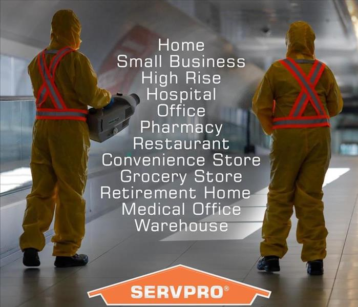 Image shows 2 SERVPRO employees with their backs to the camera with a list of different commercial facilities between them.